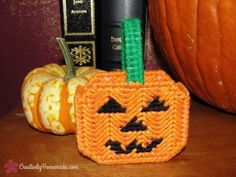 Make a cute doll sized Halloween candy bucket with the free plastic canvas pattern for Halloween