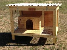 Rabbit Hutch with added caster wheels and rabbit box.