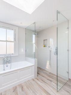 Victorian property renovation | walk in shower | glass screen | rooflight | wood effect tile flooring | bathroom | sash window | white tiles |