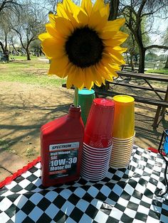 Motor oil can as vase for car party. #carparty