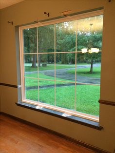 Big picture windows opened the entire room up.  Now just time for some new trim to finish them up!