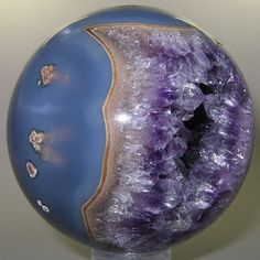 Polished mineral spheres at this site are amazing. This one is an Amethyst from Brazil