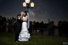 Wedding photography, bride groom kiss, lamp post, sunset, flowers, stars, dress, Vail