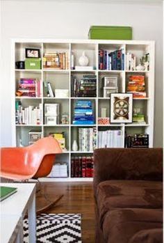For my tiny living room (where storage is a MAJOR issue), this book shelf would be floor to ceiling, wall to wall, directly across from the front door. I'd love for my turntable and records to fit nicely inside as well as the trillion books and little keepsakes I own.