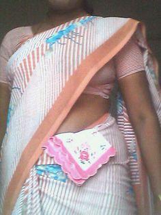 Photo in Women tucking handkerchief is saree waist - Google Photos Beach Mat, Saree, Popular, Google, Photos, Women, Fashion, Moda, Pictures