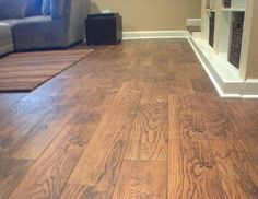 Many tile manufacturers supply wood-look tile, a great flood-resistant option for finished basements.  This picture is from a basement project we recently completed in Wilmette.