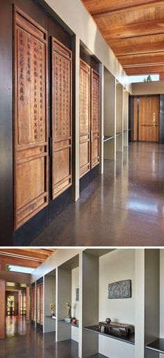 In this hallway, there's display shelving for the home owners art collection, and a set of antique Chinese wood panels have been inset into blackened-steel framing. #Hallway #InteriorDesign