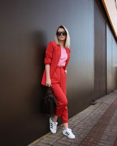 red and pink outfit • pink t-shirt, red blazer, red suit pants, adidas superstar sneakers.