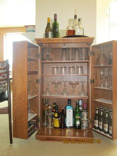 Now we use online media for both video and audio . donated the CD/DVD collection. So I repurposed CD/DVD Cabinet into a bar. & Liquor Cabinet....this looks like an old VHS cabinet one of my ...