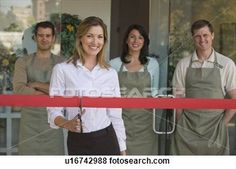Pictures of Small business owner cutting red ribbon at grand ...