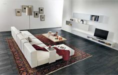 White and grey living room with a classic Persian Carpet.  It's a very good color combination.