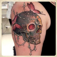 This Tatto is so awesome. I'm not a skull loving guy but this is whole new art from the rest