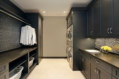 47 interessante Waschküche-Einrichtungsideen modern laundry room interior in black with built-in washing machines made of inox Laundry Basket Storage, Laundry Room Organization, Laundry Room Design, Laundry Closet, Small Laundry, Modern Laundry Rooms, Modern Room, Laundry Room Cabinets, Diy Cabinets