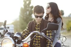Stylish young couple on a motorcycle.
