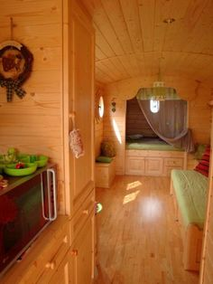 This is a tiny house but it could also work as the inside of a trailer ~ Love the stain wood color. Bright and lovely. Beautiful bed in the back. Perfect! Springwolf