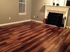 """""""We bought a house that needed to be brought into this century, and the new laminate really helped do the trick! We put in new blinds, painted, and laid the Natural Acacia laminate flooring. It is amazing how much different the room looks!"""" – Tyler, KY http://www.lumberliquidators.com/ll/c/pad-Natural-Acacia-Laminate-Dream-Home-Kensington-Manor-12NA/10027477"""