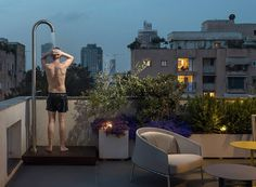 this holiday apartment in tel aviv features open rooftop terrace with shower on it - 4 Tel Aviv, Roof Deck, Roof Top, Best Insulation, Our Town, Terrace Design, Holiday Apartments, Brick Building, Rooftop Terrace