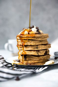 Beautiful whole grain banana bread pancakes that are perfectly sweet and fluffy. Made with whole wheat flour and dairy free too!