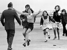 Robert L. Stirm greeted by his family at Travis Air Force Base in Fairfield, California, as he returns home from the Vietnam War.