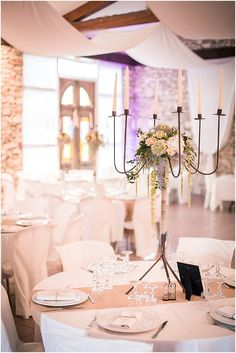 Candelabra romantic wedding centrepiece | Image by Matt Guegan, see full wedding http://www.frenchweddingstyle.com/wedding-in-tarn-france/