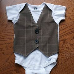 Absolutely LOVE this DIY Faux Vest Onesie! I can't search through my fabric stash fast enough!!!