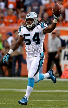 Carolina Panthers linebacker Shaq Thompson holds the ball up after recovering a…