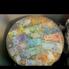 travel table with currency from around the world....good idea Abbie?