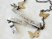 Better to have loved and lost.., a classic Tennyson quote. His timeless words are a reminder that life and love can be fleeting, so cherish the moments and embrace loss and pain, for through it can come new strength, courage and growth.  This ribbon-like banner has been hand-formed out of sterling silver. The fluttering monarch butterflies are hand-sawn out of brass. $132.00
