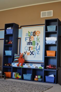 3 bookcases screwed together! Love the little bench it creates! Playroom idea