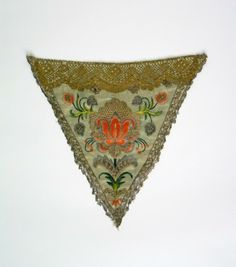 Stomacher, c. 1740-1760. Plae green silk satin embroidered with floral motifs, decorated with metal lace