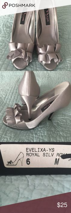 Nina Evelixa silver satin heels Awesome pumps.  Silver satin very sexy. Never been worn. New in the box with dust bag Nina evelixa Shoes Heels