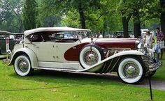Vintage Cars 1934 Duesenberg SJ Lebaron Model Dual Cowl Phaeton, Light Gray and Maroon. Old Classic Cars, Classic Trucks, Duesenberg Car, Auto Retro, Bmw Autos, Classy Cars, Unique Cars, Amazing Cars, Hot Cars