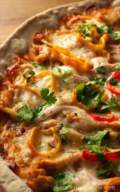 "Thin Crust Barbecue Chicken Pizza - amazingly delicious and easy to make! The barbecue chicken shares the spotlight with onions, peppers and cilantro. A perfect pizza for those, ""What's quick for dinner?"" nights."