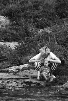 August Prince Harry and his mum, Lady Diana play on the banks of the River Dee, near Balmoral Castle during a summer vacation in Scotland.