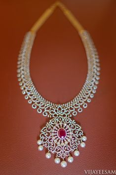 Diamond necklace embedded with ruby gem which suits with a cool soothing attire to give the bride a royal look. Diamond Earrings Indian, Diamond Jhumkas, Diamond Choker Necklace, Diamond Bangle, Diamond Jewellery, Ethnic Jewelry, Indian Jewelry, Gold Jewellery Design, Chocker