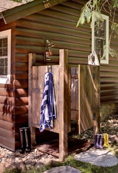 Outdoor shower - A Comfy Northwoods Cabin Renovation - Cabin Life magazine - Photo by Rick Hammer, courtesy Lands End Development & BeDe Design