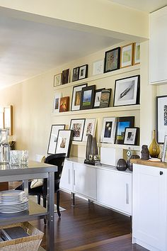 I love the idea of setting little shelves for frames - via #decoratrix