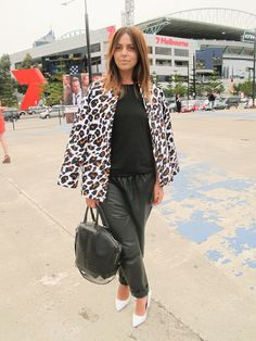 Spicing up the monochrome look at #LMFF with an abstract #leopard coat worn over the shoulders, perfectly punctuated with her white pointed heels and structured Alexander Wang tote.  WGSN street shot, L'Oréal Melbourne Fashion Festival