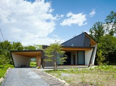 Magnificent Wood Ideas of Trapezoid Minimalist House: Modern Yatsugatake Villa Facaed With The Grey Wall And Wide Glass Walls Near The Green...