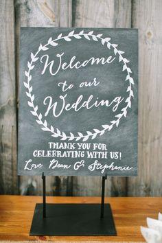 Slate wedding sign: http://www.stylemepretty.com/2015/05/26/rustic-elegant-ithaca-farm-wedding/   Photography: Caroline Frost - http://carolinefrostphotography.com/