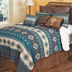 A Lone Star Western Décor Exclusive - Give your bedroom a southwest upgrade with this polyester bedding featuring a diamond and arrow print in rich cream and blue tones. Sets include quilt and two shams. Machine wash.