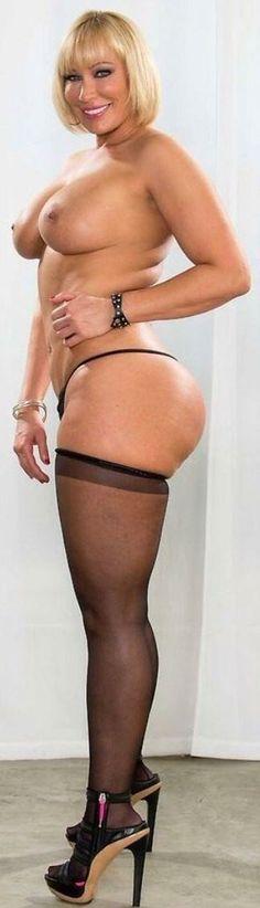 ASTV-Unreal big blonde hottie in stockings.