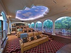 Is that a garden outside? Cleverly placed pillars and a life-like mural transport this home theater to the landscapes of Italy.