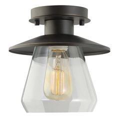 Features:  -Oil rubbed bronze finish with clear glass shade.  -Ideal for use in basements, bathrooms, bedrooms, dining rooms, entryways, hallways, kitchens, and living rooms.  -Includes all mounting h