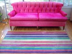 hot pink sofa and striped rug