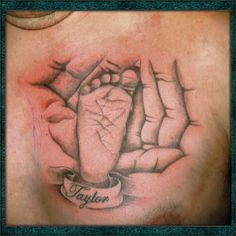 Baby footprint tattoo in fathers hand tattoo.  www.scarred4life.com.au/images/stories/cosigallery/foot1_1.jpg