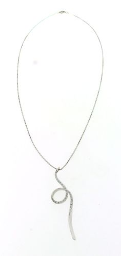 Necklace in 18ct white gold, modern feature, with a pendant ornamented with 27 brilliant-cut diamonds of total approx. 0,45ct, pendant length about 6cm, chain length about 50cm, weight 8,5grams