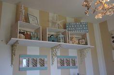 Beach theme nursery! Love the crates on the wall with beach-y items :) CUTE!