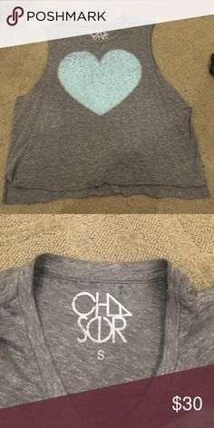 Grey chaser muscle tee with turquoise heart Grey chaser muscle tee with turquoise heart. Super soft and comfy and great condition. Might need to wear a tank or bandeau under it if the sleeves are too low cut. Chaser Tops Muscle Tees