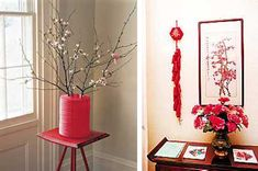 Table centerpieces, blooming flower arrangements and wall decorations for Chinese New Year celebrations